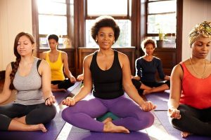 20 Oct 2012, Brooklyn, New York City, New York State, USA --- Women meditating in yoga class --- Image by © Granger Wootz/Blend Images/Corbis